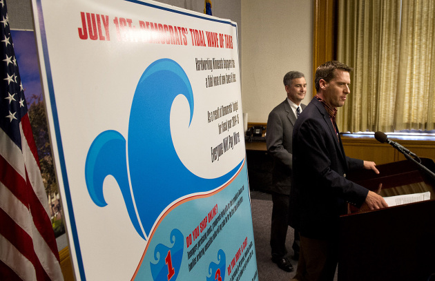 Next to a poster reading July 1st, Democrats tidal wave of taxes, Senate Republican Leader David Hann and House Republican Leader Kurt Daudt discussed  the impact of new taxes imposed by the democrats on Monday, July 1, 2013, the first day of the new biennium.   ]   GLEN STUBBE * gstubbe@startribune.com