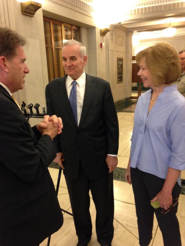 Mark Dayton, center, and Tina Smith talk with Secretary of State Mark Ritchie