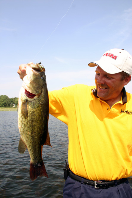 "Tom Braaten with a six-pound largemouth bass from a lake known for ""producing lots of small bass"""