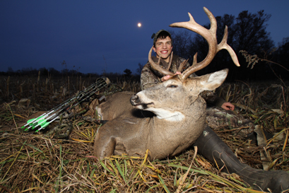 Brody Boese of Elk River with a trophy drop-tine buck he arrowed in November