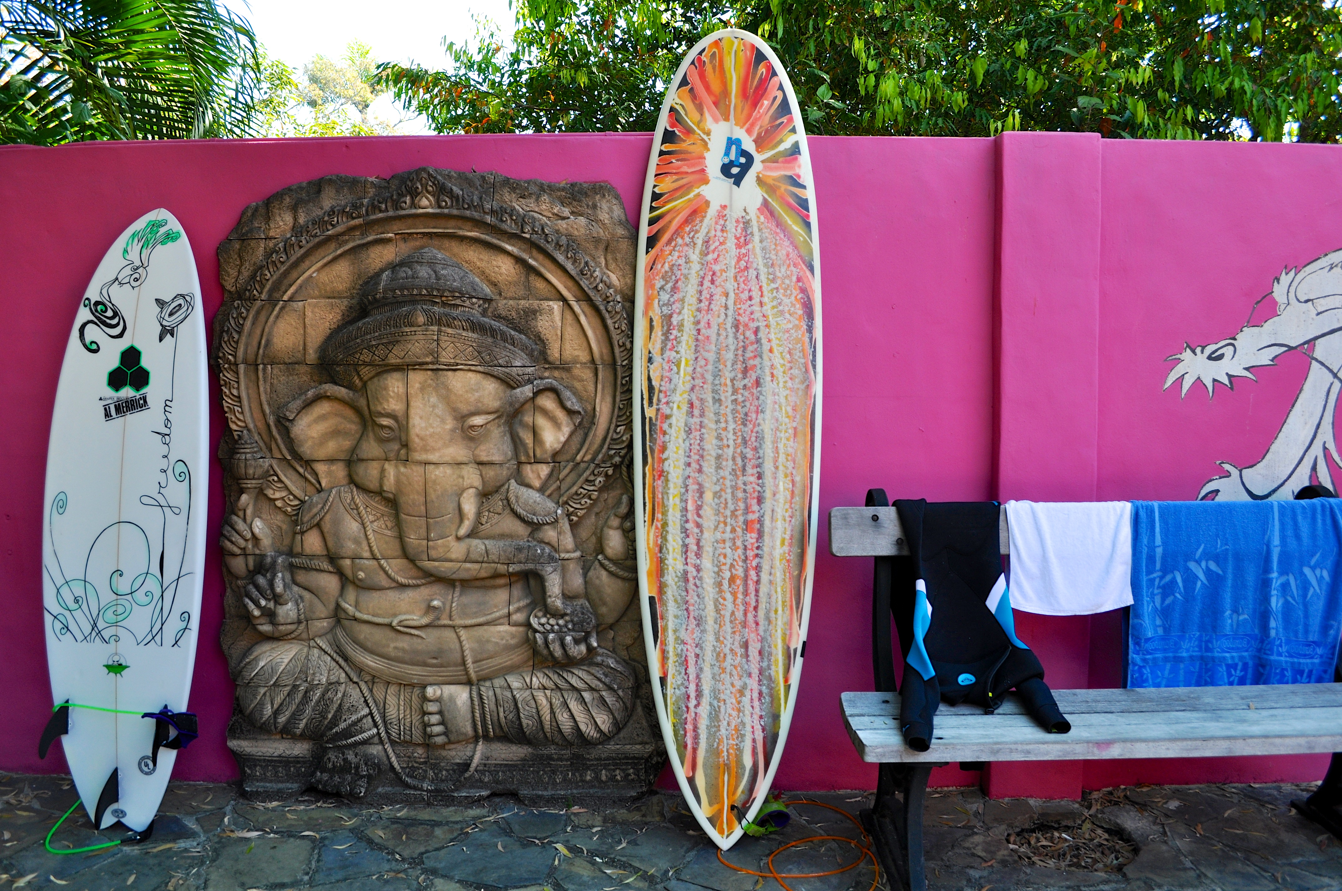 Surfboards at the all pink painted hostel
