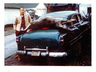 The author's father with his first doe taken in the 1960s. Love the car!