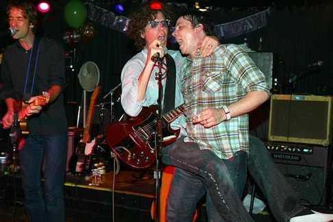 Jim Boquist, Gary Louris and Jeff Tweedy got extra close for a 2003 Golden Smog gig at the 400 Bar. / Jeff Wheeler, Star Tribune