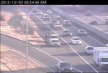 Two cars on the right shoulder at Hwy. 100 and France Av. in Brooklyn Center