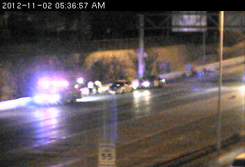 Troopers and an ambulance on the scene of a crash on 35E