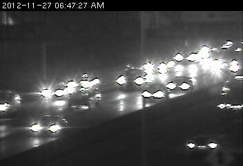 A vehicle blocking the center lane just north of 106th St. on 35W