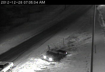 Vehicle in ditch at 28th Avenue.