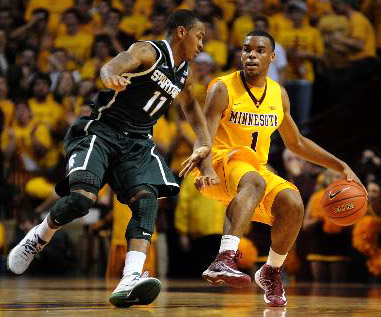 Andre Hollins brings the ball up court against Michigan State's Keith Appling. Richard Sennott / StarTribune.com