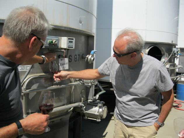 "David pouring Gary some wine out of tank (before barreling); it's nice to see and taste wine ""in process"""