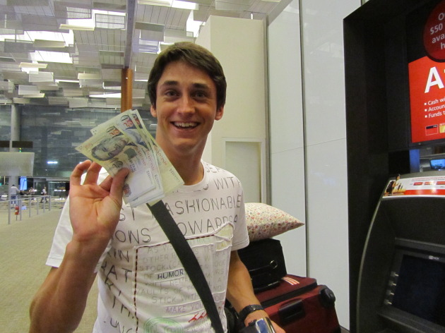 Johan with Singaporean Money