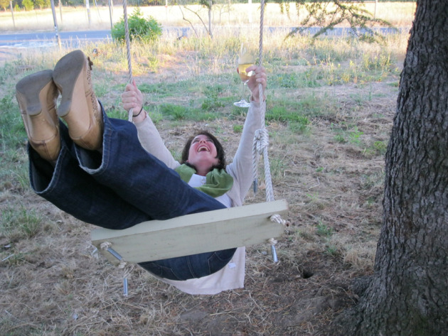 Wine colleague and friend, Sara. Note: when on a wine trip, wine can be enjoyed on wooden swings.
