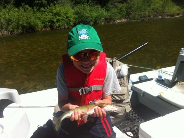 Charlie with his first trout on a fly