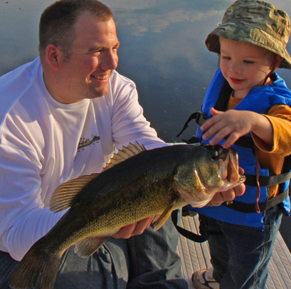 """The author with a """"rockin' big bass"""" as his two-year old likes to call it (caught by the two year old legitimately)"""