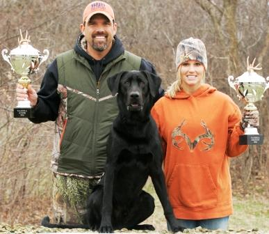 "Lee and Tiffany Lakosky, of television's ""The Crush,"" won the amateur open and junior divisions at the World Shed Dog Hunting championship with their Lab, Tank. Photo © Mark Palas"