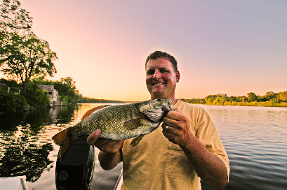 Mark Westerman with a late August smallmouth and plenty of beautiful scenery