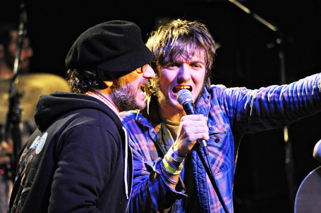 "Honeydogs singer Adam Levy, left, shared the mic with ""Dose of Thunder"" contest winner Erik Hendrickson"