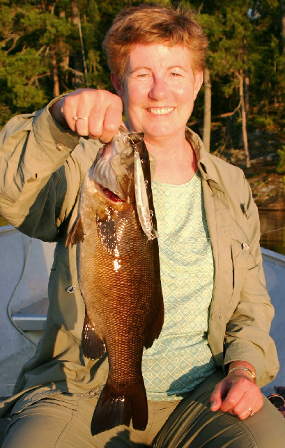 Ginger Hustvedt with a chunky smallmouth bass