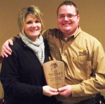 Michelle Nelson receives the North Dakota Pheasants Forever MVP Award from Jesse Beckers, Pheasants Forever Regional Wildlife Biologist.