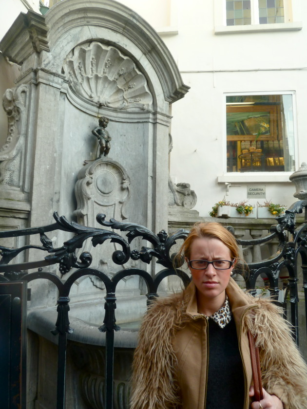 Posing with the Mannekin Pis- recreating a photo from when I was younger and absolutely DISGUSTED that anyone could expect me to take a picture with a BOY PEEING. EW.