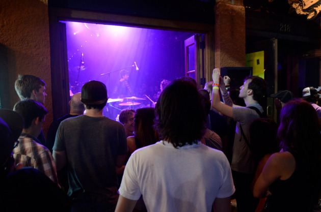 Fans watched Polica from outside the Bat Bar on Sixth Street.