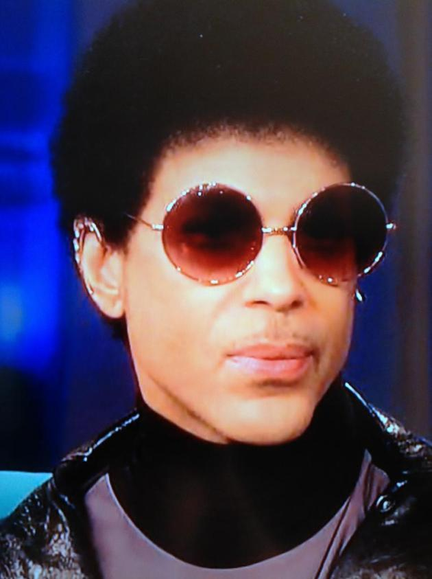 "Prince sported a tighly cropped afro and wire-rim sunglasses Wednesday, much like his look on ABC's ""The View"" in December."