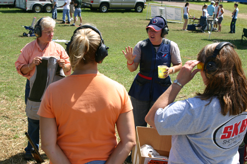 Kim Rhode and Loral I Delaney taught women shooting skills at Game Fair during her visit.