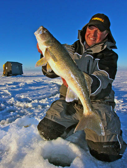 Tony Roach of Roach's Guide Service on Mille Lacs with a quality mid-winter walleye