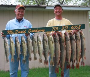 "KFAN's ""The Captain"" Billy Hildebrand and Devils Lake guide Aaron McQuoid show off the day's catch"