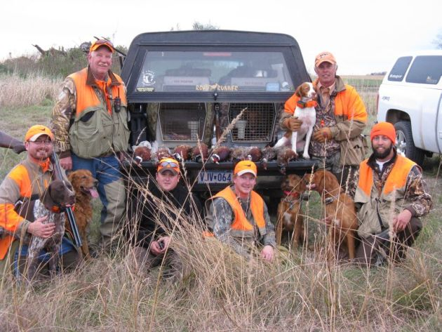 (left to right) Bob St.Pierre, Steve Kuyper, Brian Zustiak, John Kuyper, Billy Hildebrand, Erik Hildebrand and Matt Kucharski (operating the camera) with 9 roosters before hunting the day's final walk.