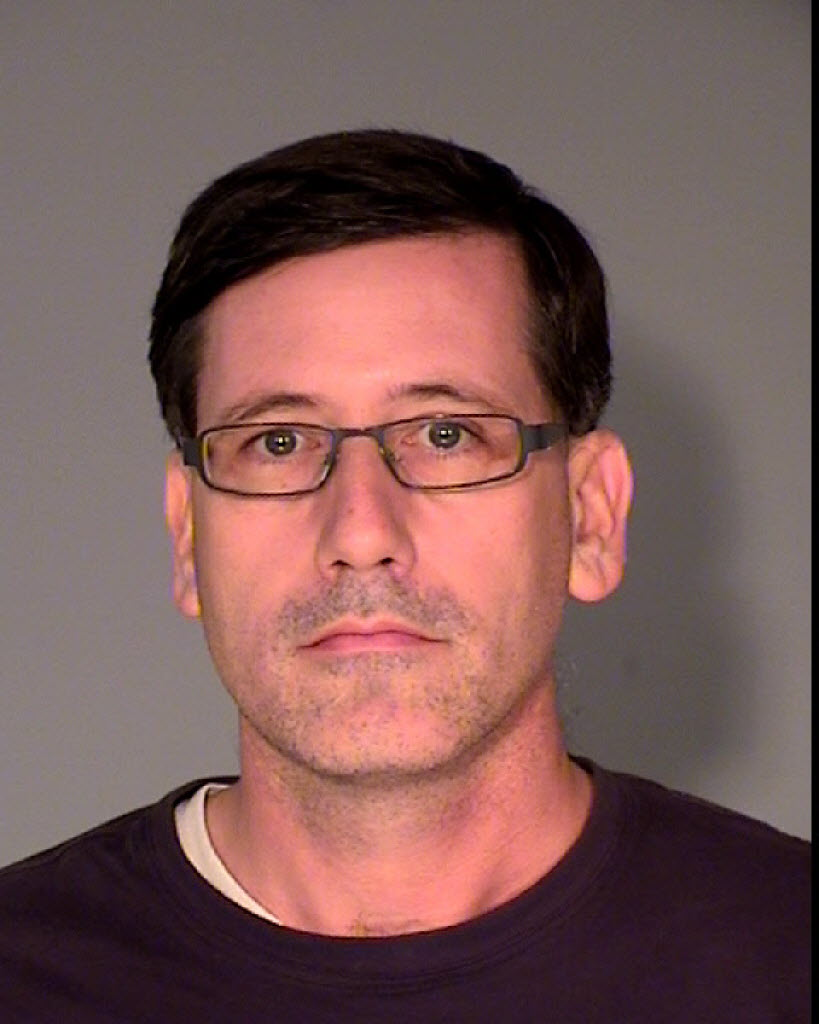 Michael J. Mangan, who is in prison for stalking his ex-wife and her supporters, faces fraud charges in federal court.