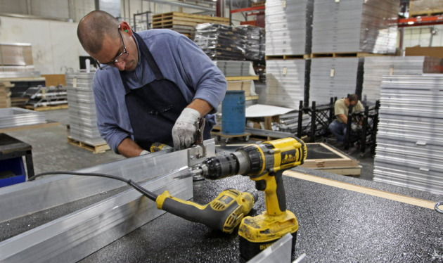 Kirk Stewart of Staging Concepts drilled the frame of a stage platform he was fabricating at the Brooklyn Park headquarters in 2011. Behind him were stacks of stage platforms destined for customers in Canada and Venezuela. (Bruce Bisping/Star Tribune)