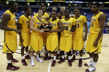 Gophers players holding their trophy after winning last year's tournament in Puerto Rico.