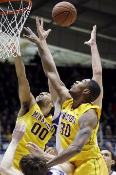 Julian Welch (00) and Andre Ingram (30) battle for a rebound against Northwestern