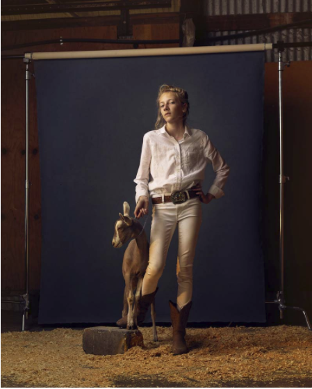 A photographer captures goat losers at Minnesota county fairs