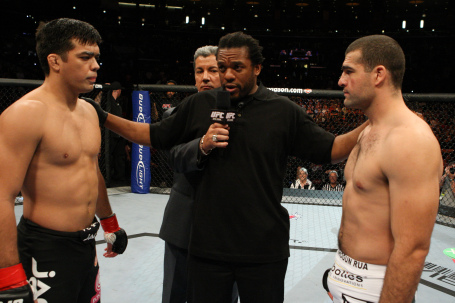 Referee Herb Dean (middle) gives instructions to Lyoto Machida (left) and Mauricio Rua (right) as announcer Bruce Buffer looks on (Photo courtesy of UFC)