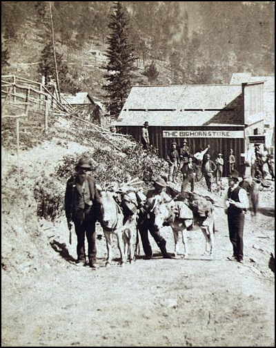 Outside Deadwood's Bighorn Store in 1876.