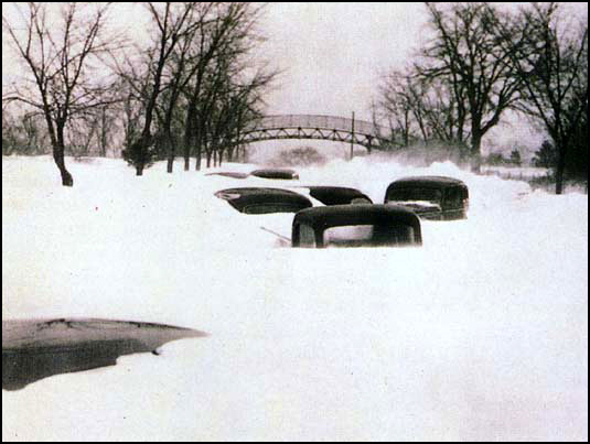 Only the tops of cars are visible in this view of snowbound Excelsior Boulevard, looking west toward the Minikahda Golf Club overpass in Minneapolis.
