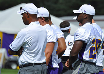 Peterson stood on the side and watched during the Vikings' first walk-thru of training camp.