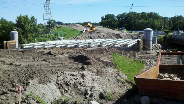 This partially finished bridge over Bassett Creek will carry Van White Boulevard.