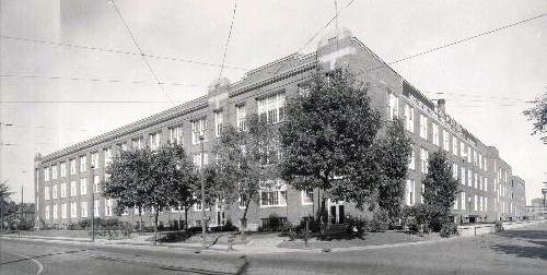 The old bulb factory turned school headquarters is on the block for sale.