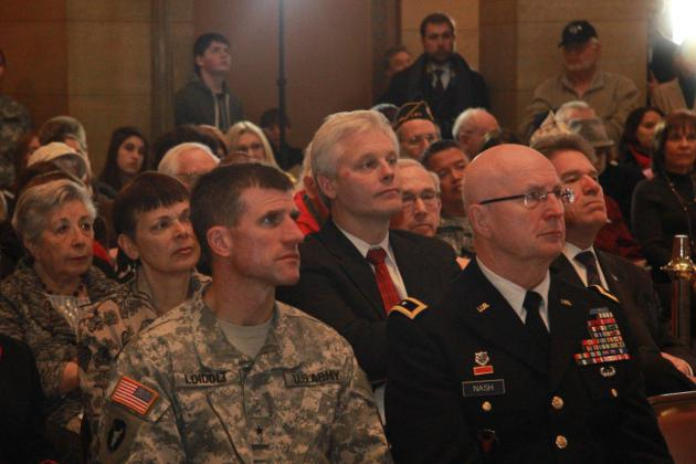 Foreground: Brigadier General Loidolt (left) with Major General Nash at the Minnesota State Capitol. Background: (L to R) Senator Sandy Pappas, Speaker Paul Thissen, and Secretary of State Mark Ritchie at the Minnesota State Capitol.