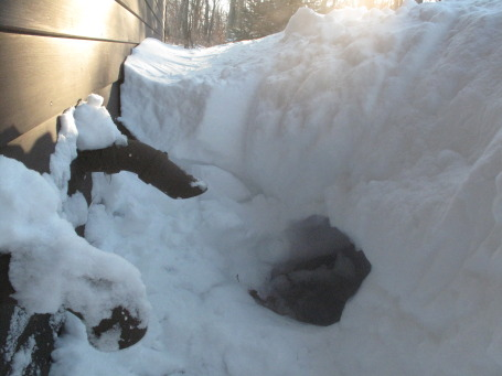 The furnace air intake (at left) and the exhaust (right) after being dug out of a deep snow drift.