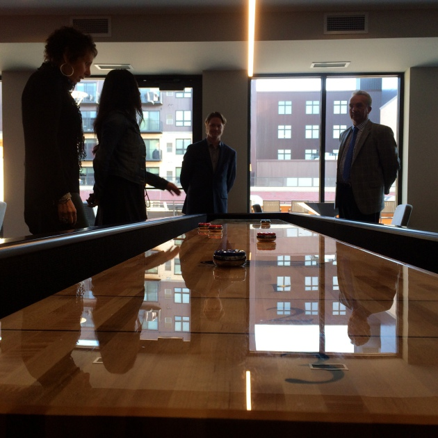 Shuffleboard anyone? Builder owners, Paola and Luigi Bernadi of Sentinel Management and Aurora Investments; site manager, Amanda Kelzenberg and Nick Murnane, real estate manager for Opus Development.