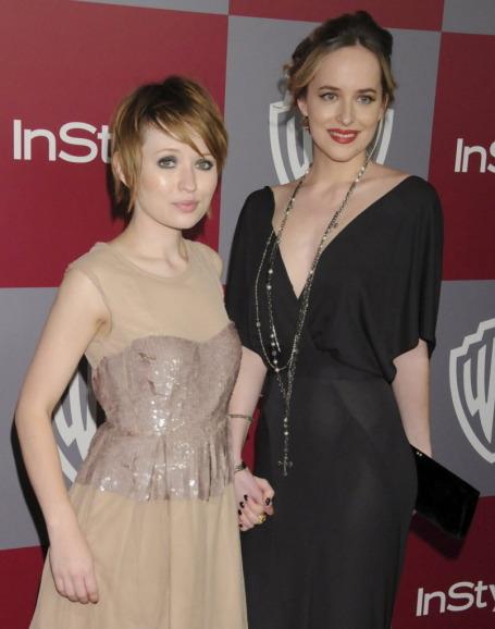 Dakota Johnson (right) is a busy woman.