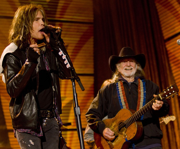 Steven Tyler joined Willie Nelson at last year's Farm Aid in Milwaukee. / Associated Press