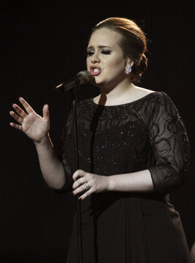 Adele in healthier times at the Brit Awards in February. / Photo by Joel Ryan for AP