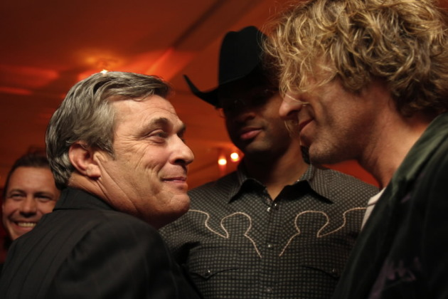 Mick Anselmo, left, chatted with Big Kenny (Big & Rich) and Cowboy Troy at the CMA Awards in 2005. / Star Tribune file