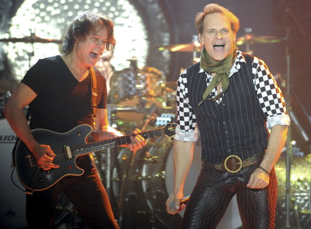 Eddie Van Halen, left, and David Lee Roth were still smiling at Van Halen's recent concert in Reading, Pa. / AP Photo/The Express-Times, Matt Smith