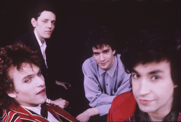 "Bob ""Slim"" Dunlap (back left) Chris Mars (front right) and some other guys who used to be in the Replacements, circa 1989. / Sire Recorrds publicity photo"