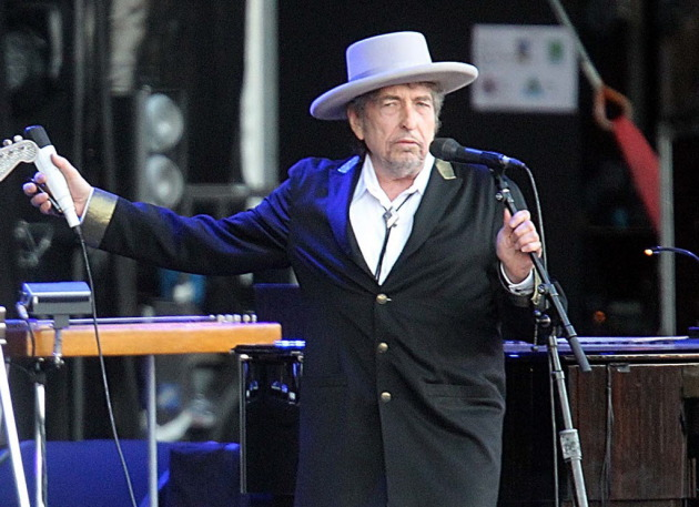 Bob Dylan, shown in France this summer, stood and swaggered for a handful of the songs Wednesday at Xcel Energy Center. / AP Photo, David Vincent